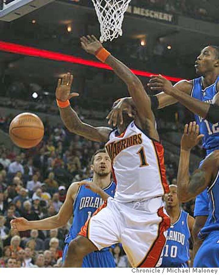 1ab0fd6c2585 Orlando Magic Dwight Howard (12) gets his hand on Golden State Warriors  Stephen Jackson s