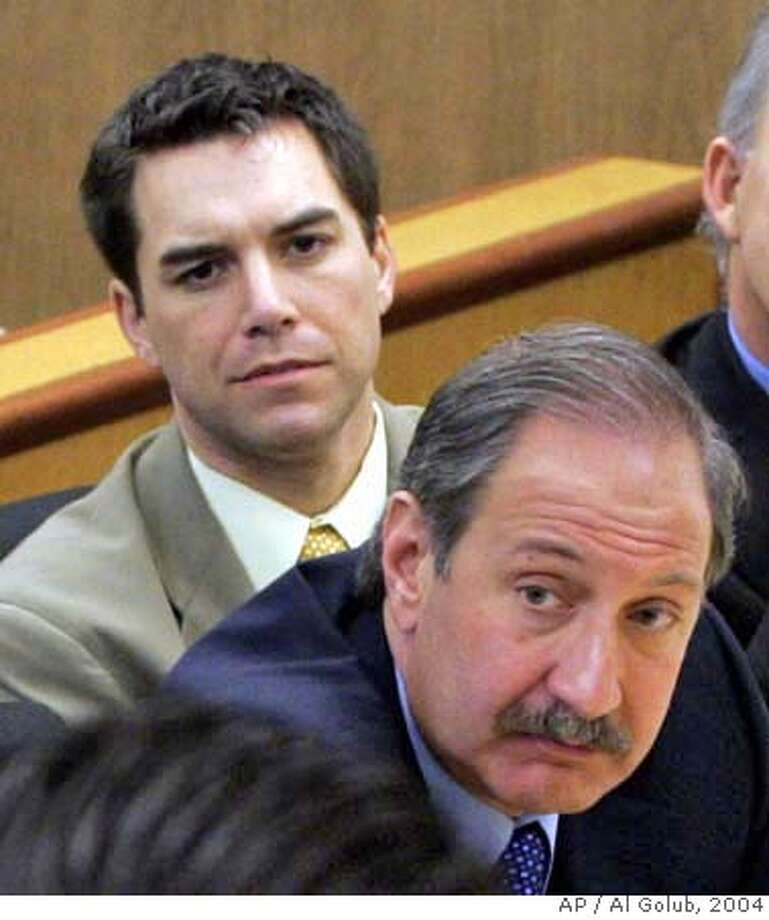** FILE ** Scott Peterson, left, and attorney Mark Geragos listen during prosecution rebuttal to the defense closing arguments in Redwood City, Calif., in this Nov. 3, 2004 file photo. A year ago, Geragos was the king of celebrity defense lawyers, heralded on TV talk shows as the new American legal superstar. How his fortunes have changed. In a stinging defeat, Peterson's five-month trial ended with a jury recommending that he be put to death for killing his pregnant wife. (AP Photo/Al Golub, Pool, File) Ran on: 12-15-2004  Scott Peterson (left) and Mark Geragos listen to closing arguments of during Peterson's murder trial in November. Ran on: 12-15-2004  Scott Peterson (left) and Mark Geragos listen to closing arguments of during Peterson's murder trial in November. Ran on: 12-18-2004  Monday: Scott Peterson, who killed his wife and unborn son just before Christmas 2002. Ran on: 12-18-2004  Monday: Scott Peterson, who killed his wife and unborn son just before Christmas 2002. NOV 3, 2004 FILE PHOTO . POOL PHOTO Photo: AL GOLUB