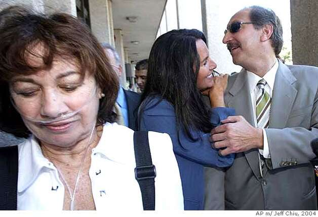 Scott Peterson, right, is greeted by crime book author Aphrodite Jones