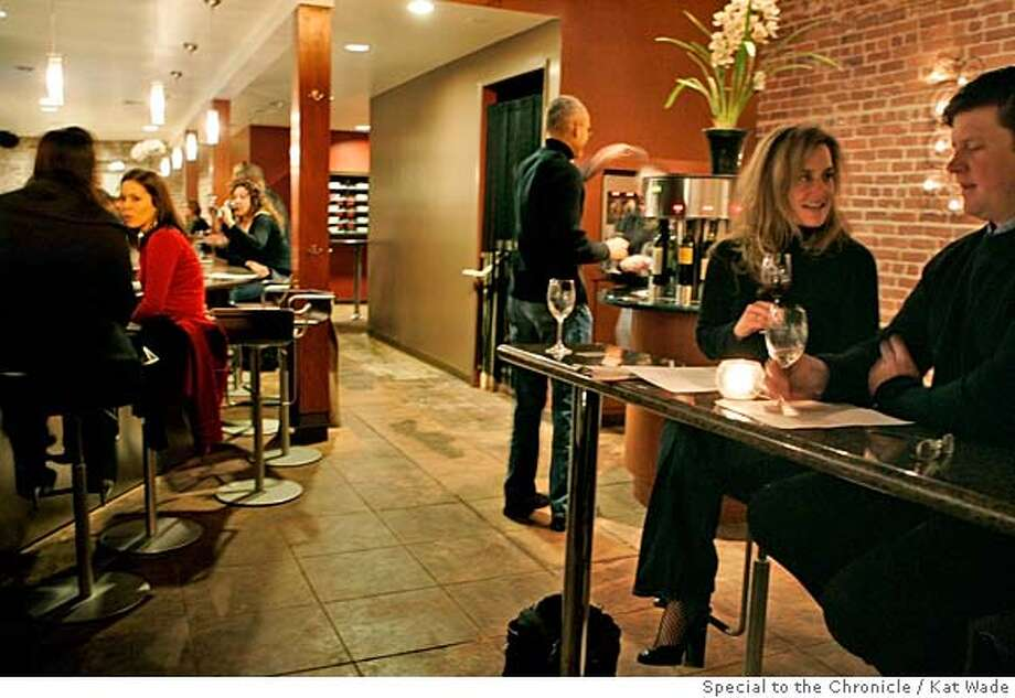 SN11_VINE_083_KW.jpg  (L to R) Nicole Cardillo and Christine Kelly sit at the bar, while Shaw Taylor chooses a wine and Laura and Steve Geist (FOREGROUND) enjoy fine wines by the taste at the Vine Wine Bar that just opened last week on Lakeshore Avenue in Oakland.  Photo by Kat Wade  Nicole Cardillo, Christine Kelly, Laura Geist, Steve Geist and Shaw Taylor (CQ, Subject) Mandatory Credit for photographer, Kat Wade Photo: Kat Wade