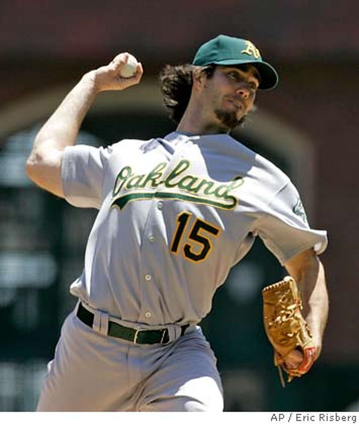 ** FILE ** Oakland Athletics' Dan Haren throws a pitch during a game against the San Francisco Giants in this file photo from June 9, 2007, in San Francisco. As the annual winter meetings approach next week, everybody wants to know whether Oakland's crafty general manager will offer up his top pitchers--All-Star Dan Haren, Joe Blanton, Harden or even closer Huston Street--to better his own low-budget operation. (AP Photo/Eric Risberg) JUNE 9, 2007 FILE PHOTO EFE OUT