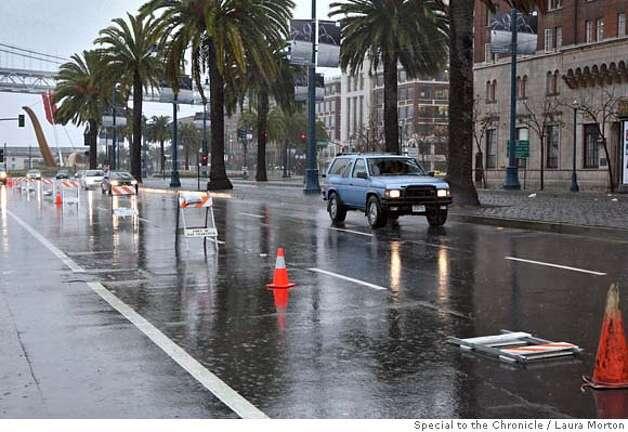 Weather05_SF_0167_LKM.jpg One lane of the Embarcadero was blocked off Friday morning due to flooding from the storm. (Laura Morton/Special to the Chronicle) Photo: Laura Morton