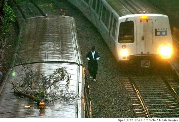 A BART train sits stranded outside the Balboa station after a tree fell across the tracks on Friday, Jan. 4, 2008. (Photo by Noah Berger) Photo: Noah Berger