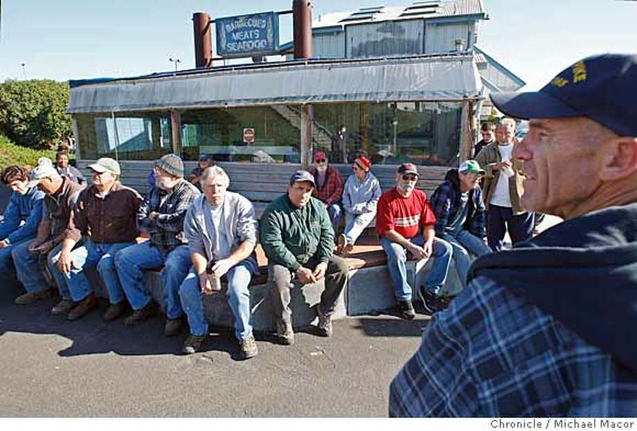 crabboat_198_mac.jpg Duncan MacLean, President of the Half Moon Bay Fishermen's Marketing Association, (right) holds an informational meeting with crab fishermen out at Pillar Point Marina, about the state of the Crab fishing off the coast. They decided to statrt fishing for Dungeness crab no ealier then 6am Saturday morning. Fishermen received the all clear to fish after the California Dept. of Fish and Game released the test results yesterday, on the condition of the crab population off the coast of Northern California following the oil spill by the container ship Cosco Busan on Nov. 7.. Michael Macor / The Chronicle Photo taken on 11/30/07, in Half Moon Bay, CA, USA Photo: Michael Macor