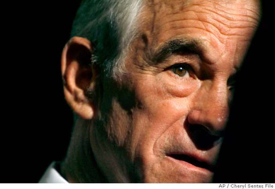** FILE ** Republican presidential hopeful, Rep. Ron Paul, R-Texas, talks to The Associated Press during an interview at Nashua High School South, in Nashua N.H. Wednesday Nov. 7, 2007. Those who dismissed Rep. Ron Paul as a joke in the Republican presidential primary aren't laughing so hard these days. (AP Photo/Cheryl Senter, File)A NOV. 7, 2007 FILE PHOTO Photo: Cheryl Senter