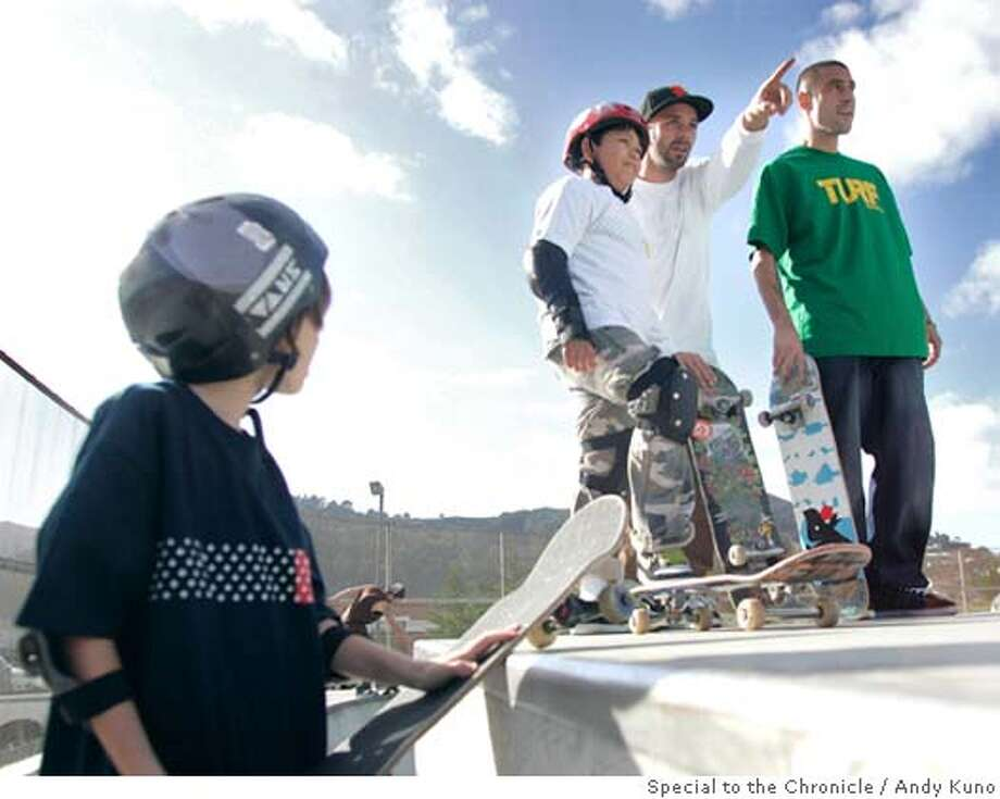 San Francisco Skate Club instructor Shawn Connelly points out a route to 10-year old Ray Bolsh (red helmet) at the Pacifica skatepark in Pacifica, Calif., Saturday December 1, 2007. ANDY KUNO/Special to the Chronicle Photo: ANDY KUNO