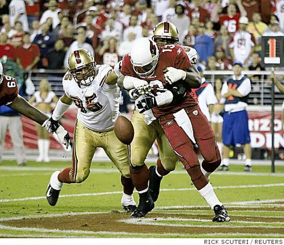 History: San Francisco 49ers defensive tackles Ronald Fields and Tully Banta-Cain (95) sack Arizona Cardinals quarterback Kurt Warner in the end zone causing him to fumble in over-time during their NFL game in Glendale, Arizona, November 25, 2007. Banta-Cain recovered the fumble for a touch down giving the 49ers a 37-31 win. REUTERS/Rick Scuteri (UNITED STATES)Ran on: 11-26-2007The 49ers' Ronald Fields wraps up Cardinals QB Kurt Warner in the end zone, setting up an improbable win in overtime.Ran on: 11-26-2007The 49ers' Ronald Fields wraps up Cardinals QB Kurt Warner in the end zone, setting up an improbable win in overtime. San Francisco 49ers defensive tackles Ronald Fields and Tully Banta-Cain (95) sack Arizona Cardinals quarterback Kurt Warner in the end zone causing him to fumble in over-time during their NFL game in Glendale, Arizona, November 25, 2007. Banta-Cain recovered the fumble for a touch down giving the 49ers a 37-31 Photo: RICK SCUTERI, REUTERS