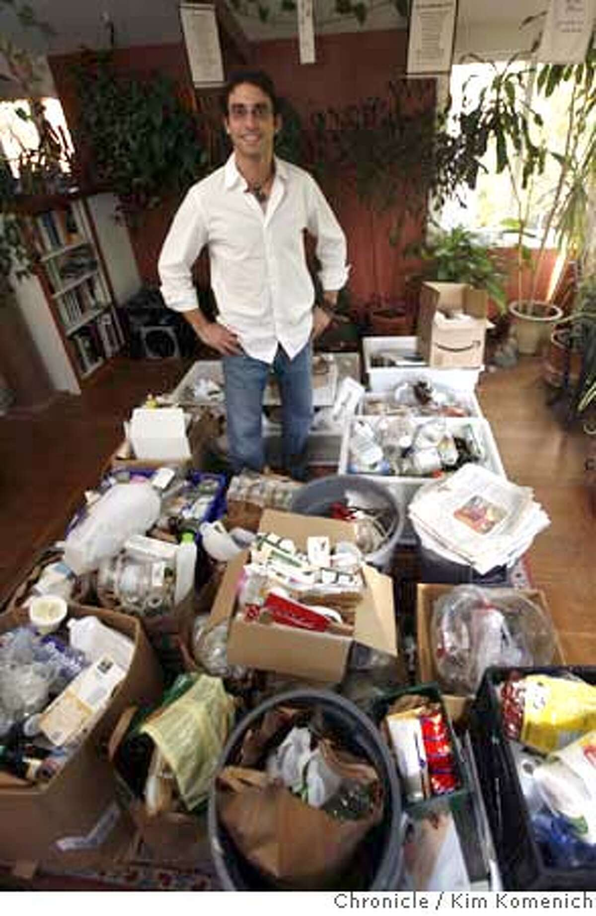 TRASHGUYXX_059_KK.JPG Ari Derfel of Berkeley has saved all of his trash and recycling for one year in an effort to see exactly how much waste one person generates in twelve months. December 4 marks the one-year anniversary of his personal project. He is sorting the stuff for a few days because he'd like to donate it to an artist who will make a statement piece out of it. Photo by Kim Komenich/The Chronicle **Ari Derfel MANDATORY CREDIT FOR PHOTOG AND SAN FRANCISCO CHRONICLE. NO SALES- MAGS OUT.