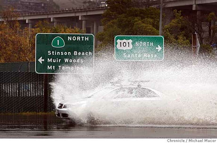 weather05_nbay_060_mac.jpg Cars push their way through the flooded roadway of Highway 1 at the 101 freeway in Mill Valley. The third storm to hit the Bay area began this morning as the work to clean up from yesterday's hugh hit began. Photo by: Michael Macor / The Chronicle Taken on 1/5/08, in Mill Valley, CA, USA Photo: Michael Macor