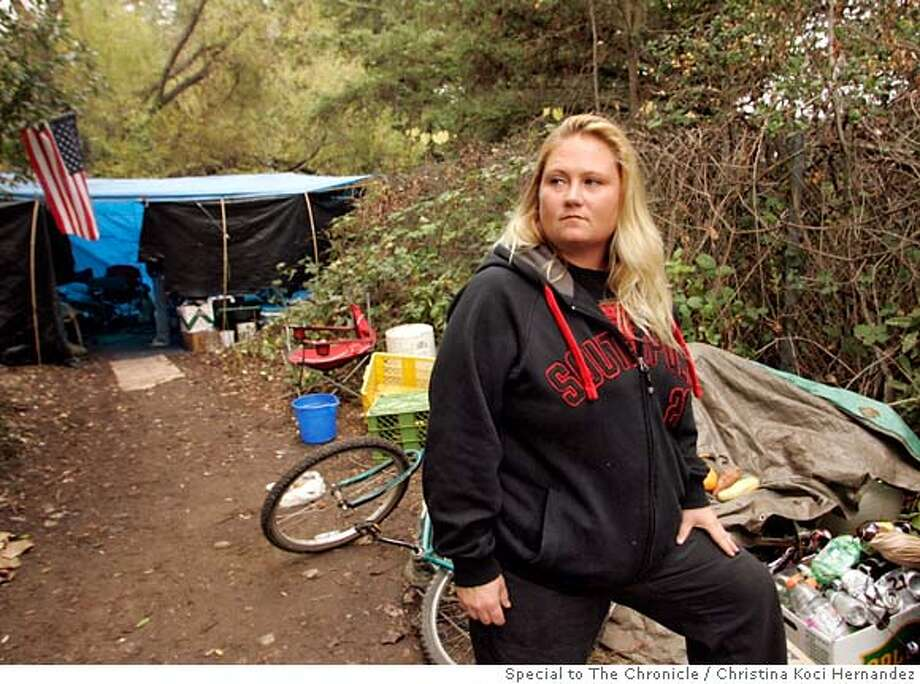 Baker revisits her old homeless encampment. Until recently, Rachel Baker, 31, lived without her children in a tent on the banks of the Russian River. She just received donations from the Season of Sharing Fund which helped her make a deposit on a three bedroom apartment in Cloverdale . Now that she's got a roof and a fulltime job, her three children are able to join her. BY CHRISTINA KOCI HERNANDEZ/SPECIAL TO THE CHRONICLE Photo: Christina Koci Hernandez