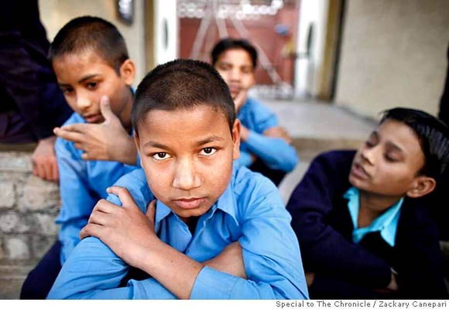 11-year old Raju sits in Mukti Ashram in North Delhi. From the state of Bihar and was recruited by his brother to come to Delhi to work 15 hour days in a factory doing hand-embroidery. zackary canepari / special to The Chronicle MANDATORY CREDIT FOR PHOTOG AND SAN FRANCISCO CHRONICLE/NO SALES-MAGS OUT Photo: Zackary Canepari