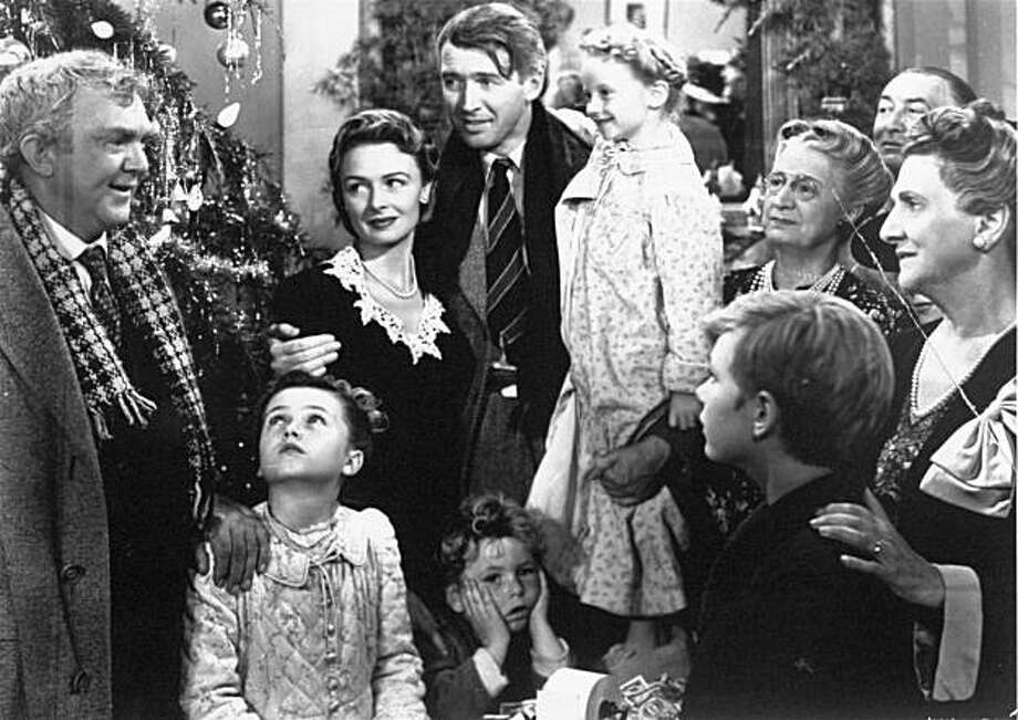 "James Stewart, center, as George Bailey is reunited with his wife, played by Donna Reed, left center, and their children during the final scene of Frank Capra's 1946 movie, ""It's A Wonderful Life."" Photo: Rko, AP"