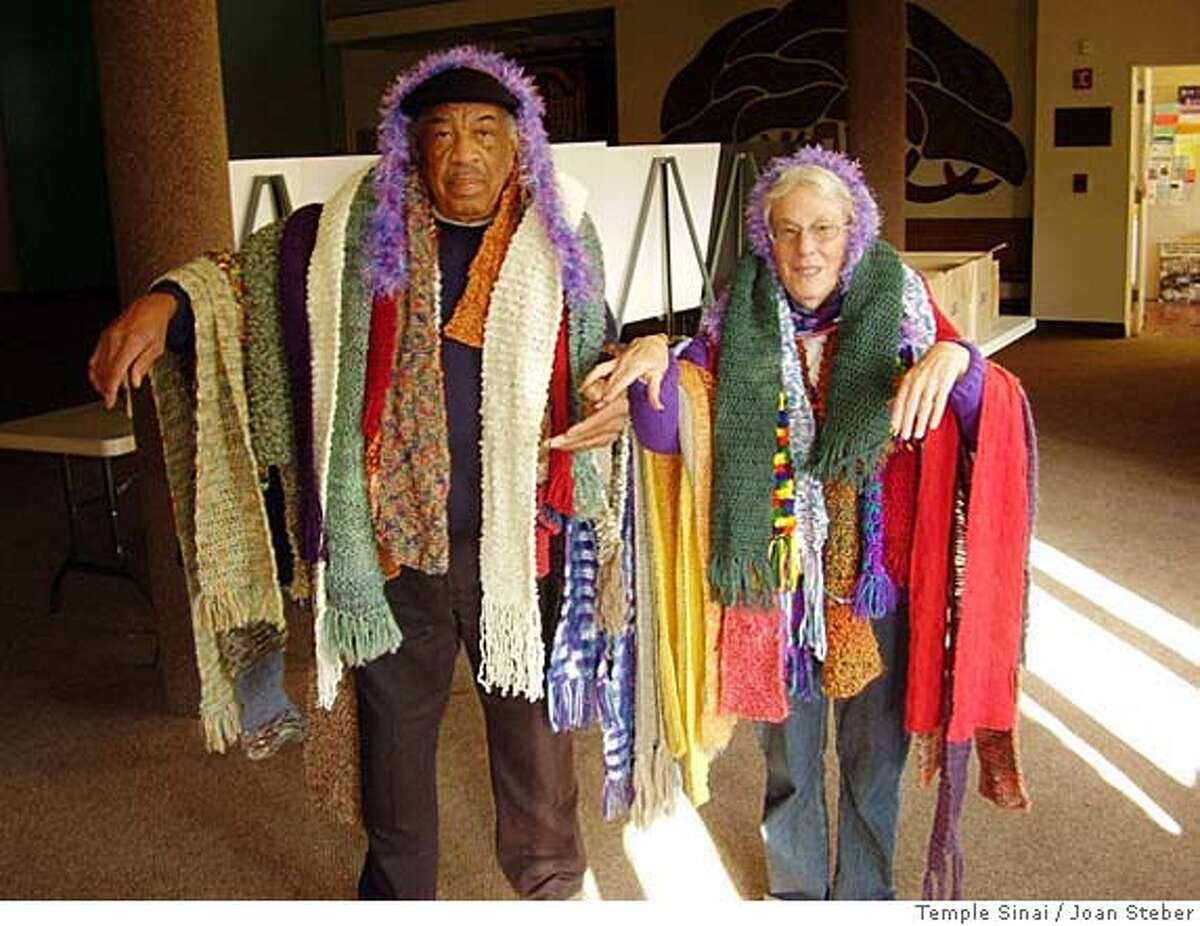 Jim White, head custodian at Temple Sinai, and Susan Levy model the new scarves. OLYMPUS DIGITAL CAMERA