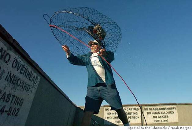 crabopen2.jpg  Larry Smith of San Jose launches a crab net off the Pacifica Pier on Friday, Nov. 30, 2007. Smith said he�d caught 32 red crabs throughout the day, but only one Dungeness of legal size. BY NOAH BERGER/SPECIAL TO THE CHRONICLE Photo: Noah Berger