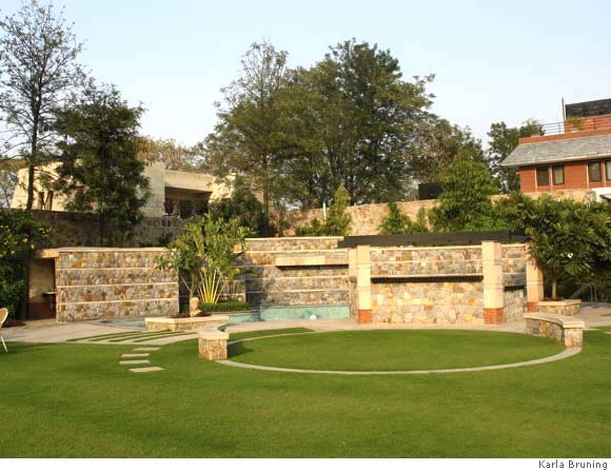 The vaastu home that's covered in Neha Singh Gohil's article. The photos should be credited to Karla Bruning. Pictured is the swimming pool.