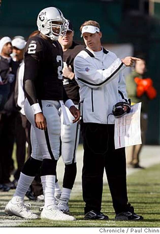 Head coach Lane Kiffin and JaMarcus Russell talk on the sideline during a timeout in the first quarter of the Oakland Raiders vs. San Diego Chargers NFL game at McAfee Coliseum in Oakland, Calif. on Sunday, Dec. 30, 2007. PAUL CHINN/The Chronicle Photo: PAUL CHINN