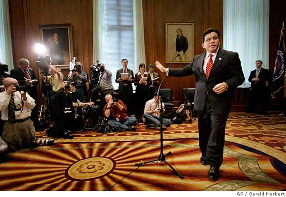 ** FOR USE AS DESIRED WITH YEAR END--FILE **Attorney General Alberto Gonzales exits a news conference after taking questions from reporters after a news conference, in this March 13, 2007, file photo, at the Justice Department in Washington. (AP Photo/Gerald Herbert/FILE) A MARCH 31, 2007 FILE PHOTO Photo: Gerald Herbert