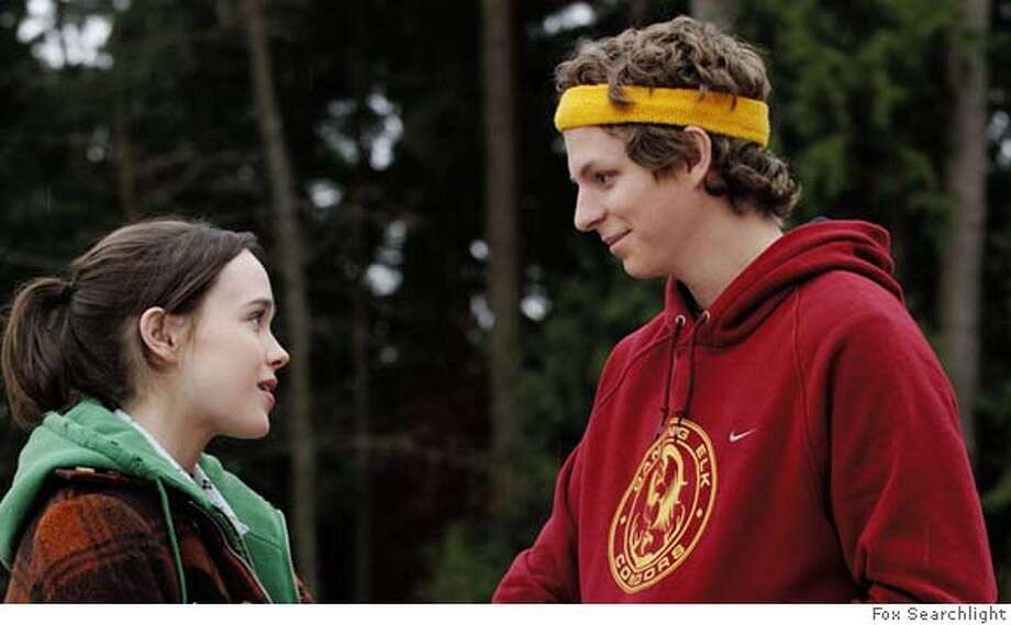"""Juno MacGuff: 'Cause you're, like, the coolest person I've ever met, and you don't even have to try, you know... Paulie Bleeker: I try really hard, actually.— Juno to Paulie in """"Juno.""""PHOTO:    Juno (Ellen Page) and Paulie (Michael Cera) share a scene in """"Juno."""" Photo: Fox Searchlight"""