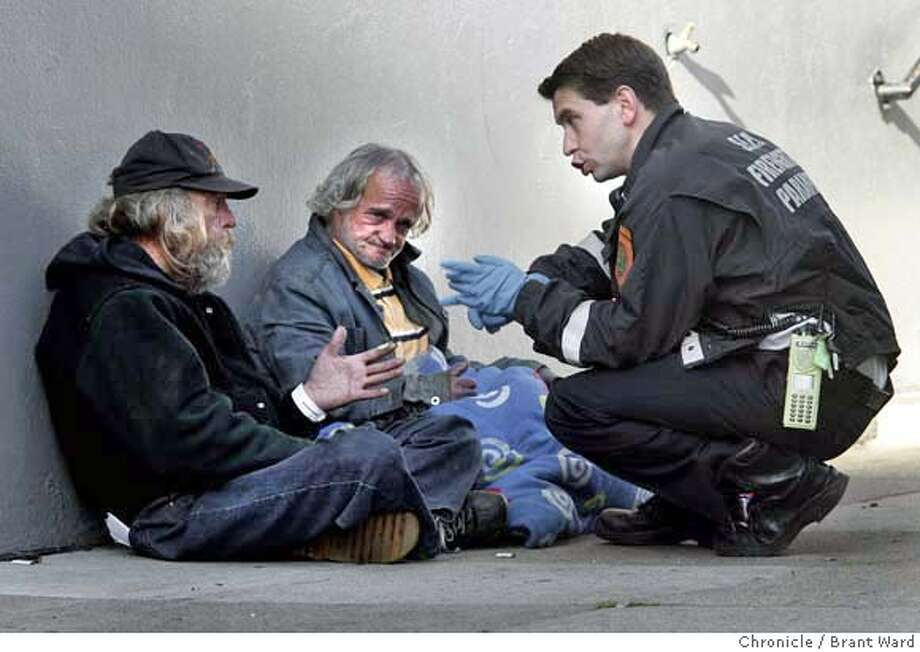 nevius18_126.JPG  Captain Niels Tangherlini, right, stops to talk with James Pond, left, and Eddie Giberson. Tangherlini often has to transfer Pond to a medical facility and is talking to him about medical services available.  Niels Tangherlini is a captain with the San Francisco Fire department and a paramedic. He drives a van stopping to help the homeless and those with chronic medical conditions get the medical help they need. He also steers people toward services and is an acknowledged good will ambassador on the streets of San Francisco.  {By Brant Ward/San Francisco Chronicle}12/13/07 Photo: Brant Ward