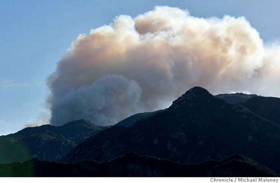 A view from the east side of the fire, looking west.  A fast-moving wildfire pushed by Santa Ana winds destroyed over 50 homes and forced thousands of residents to evacuate on Saturday as flames raced through the canyons and mountains of Malibu for the second time in little more than a month.  Photo taken on 11/24/07, in Malibu, CA.  Photo by Michael Maloney / San Francisco Chronicle Photo: Michael Maloney