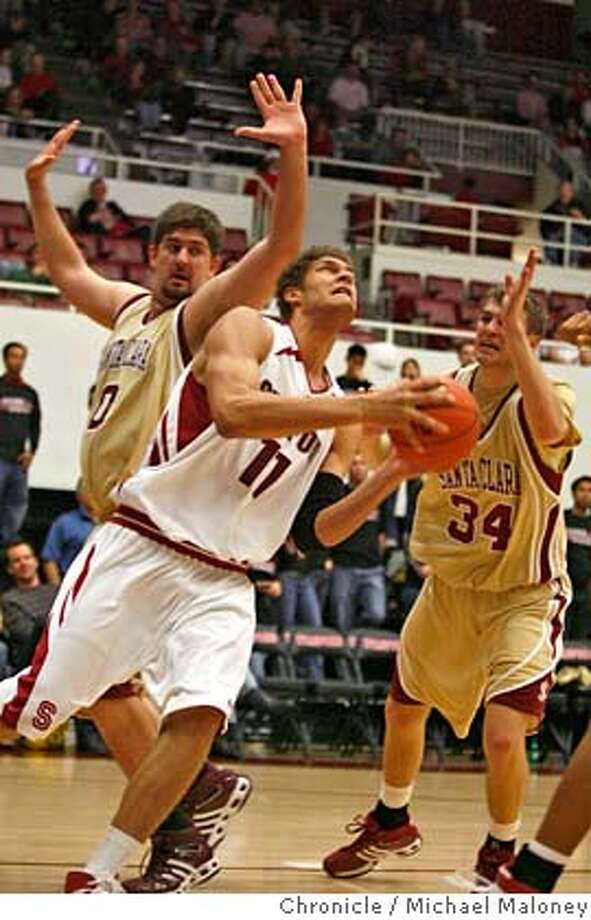 Stanford Cardinal Brook Lopez (11) looks to shoot under pressure by Santa Clara Broncos Josh Higgins (left) and Santa Clara Broncos Andrew Zimmermann (34) in the 2nd period.  Stanford University men's basketball team hosts Santa Clara University at Maples Pavilion on the Stanford campus on December 19, 2007. Stanford won 74-48.  Photo by Michael Maloney / San Francisco Chronicle MANDATORY CREDIT FOR PHOTOG AND SF CHRONICLE/NO SALES-MAGS OUT Photo: Michael Maloney