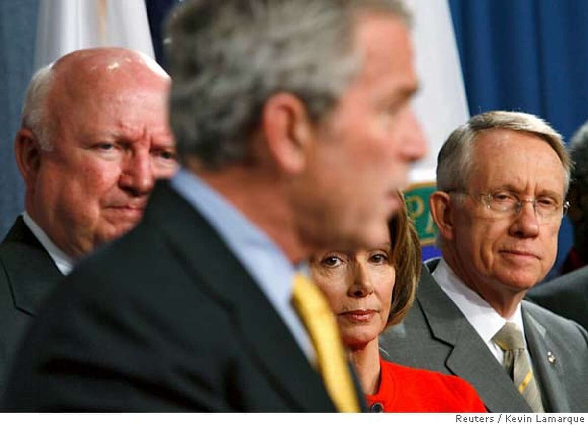 U.S. President George W. Bush speaks during a signing ceremony for the Energy Independence and Security Act of 2007 at the U.S. Department of Energy in Washington, December 19, 2007. Listening to Bush (L-R) is Energy Secretary Sam Bodman, Speaker of the House Nancy Pelosi (D-CA) and Senate Majority Leader Harry Reid (D-NV). REUTERS/Kevin Lamarque (UNITED STATES) 0