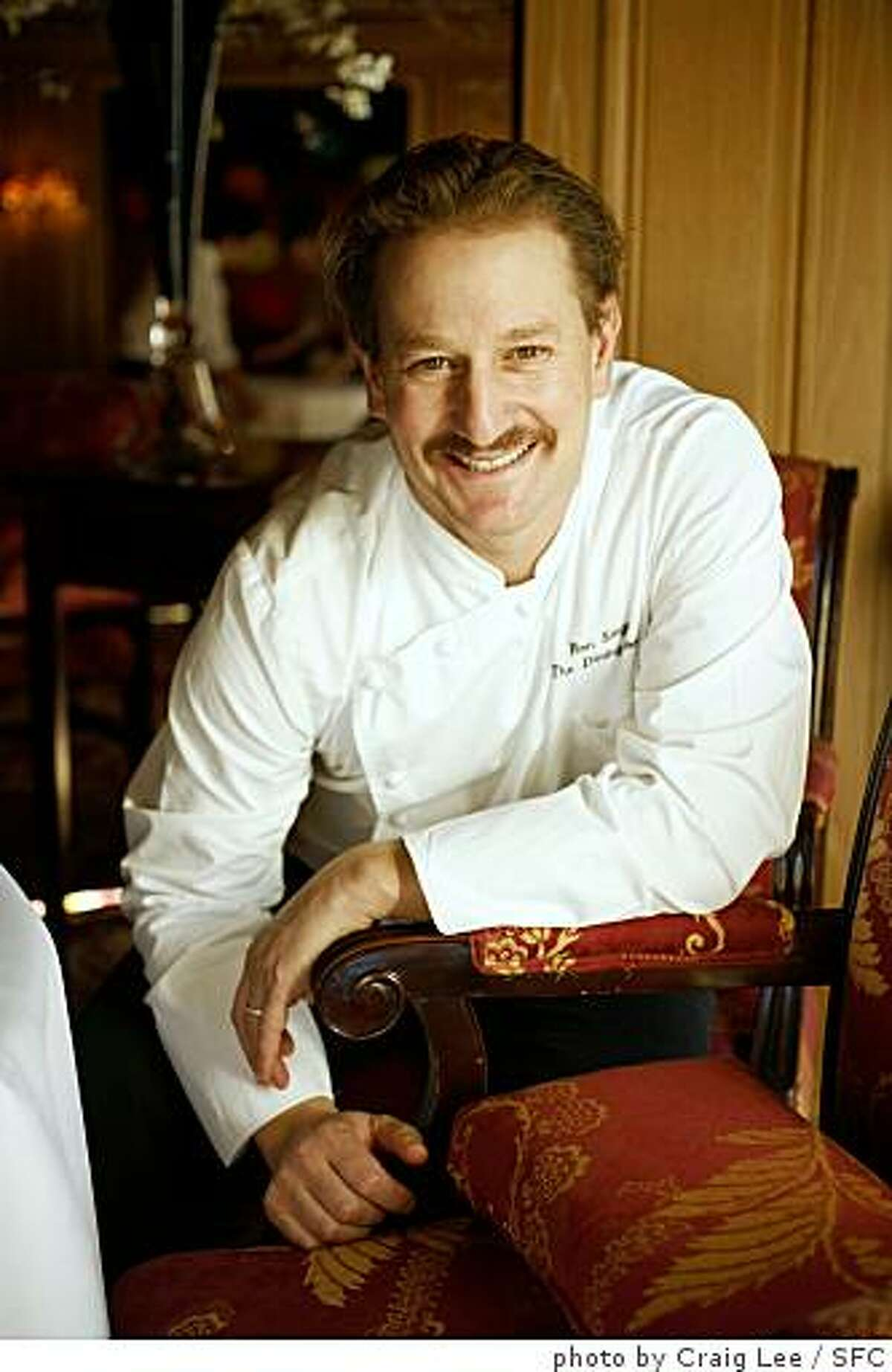 Ron Siegel, chef of the Dining Room at the Ritz Carlton, with his Christmas dish: Lamb Chops with Sunchoke Puree and Shallot Marmalade. Photo of chef, Ron Siegel.