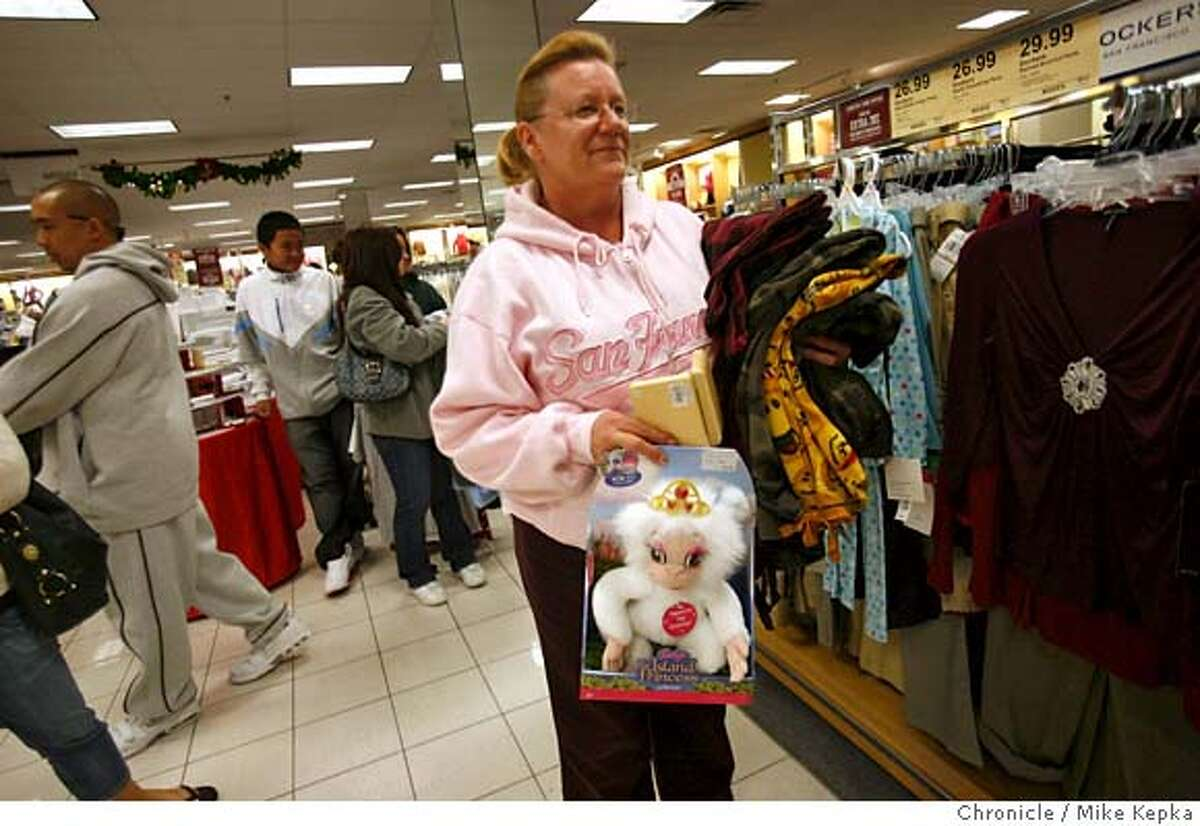 On the day after Thanksgiving, Diane Vasquez of Hayward holds an armload of potential gifts at while waiting in line at Kohl's in San Leandro's Bayfair Mall. Vasquez arrived at 7:45 a.m. after she had already been to the Pleasanton Kohl's at 4 a.m. looking for deals she couldn't pass up. Mike Kepka / The Chronicle Photo taken on 11/23/07, in San Leandro, CA, USA