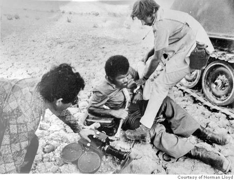 """LLOYD12_002_PG .JPG From Lloyd's personal photo collection.  The Khmer Rouge had fired a mortor and knocked the whole crew ground. This took place in about 1972 or '73. Norman Lloyd has a towel he was going to wrap around Ed Bradleys wound. The sound man at left was later killed.  Norman Lloyd is a veteran CBS News cameraman who covered the globe for 35 years, frequently covering wars: Somalia, Vietnam, Columbia, Indonesia, South Africa, Iraq. He's 63, retired since '04 and has made his first documentary. """"Shakey's Hill"""" is the story of a battalion of American soldiers with whom he spent several weeks in 1970 in Cambodia. It's about their search for a huge North Vietnamese munitions bunker. Event on 11/3/07 in Ross.  Courtsey of Norman Lloyd Photo: Penni Gladstone"""