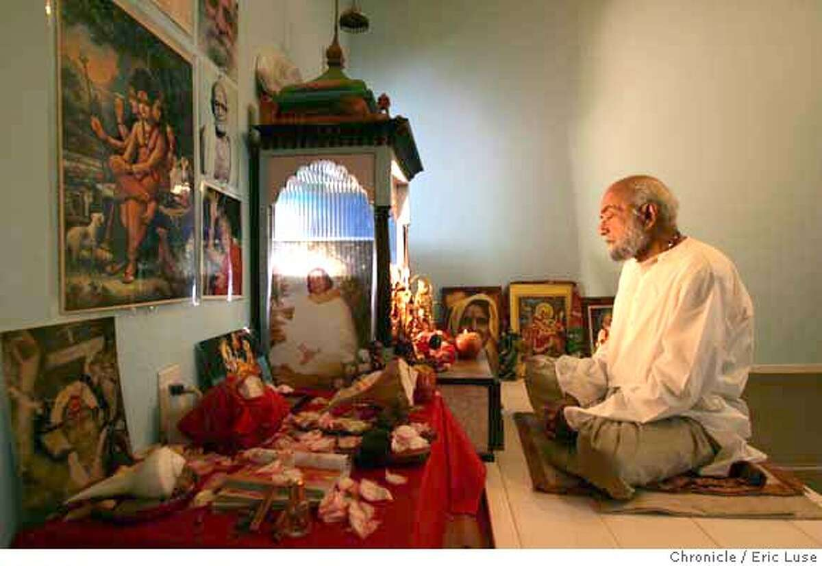"""vaastu_jani_006_el.jpg Every day Pandit Pravinji spends 3-4 hours in spiritual practice in his Puja House Temple surrounded by pictures and symbols of spiritual leaders of India. The position of elements and light coming into this room are """"perfect"""" examples of Vaastu. Pandit Pravinji and his wife Jashu Jani live the Vaastu life in his home and home temple. He is also a priest that helps people setup their homes with this idea in mind. Indian art of living Vaastu. Eric Luse / The Chronicle Photo taken on 11/15/07, in Antioch, CA, USA Names cq from source Pandit Pravinji Jashu Jani MANDATORY CREDIT FOR PHOTOG AND SAN FRANCISCO CHRONICLE/NO SALES-MAGS OUT"""