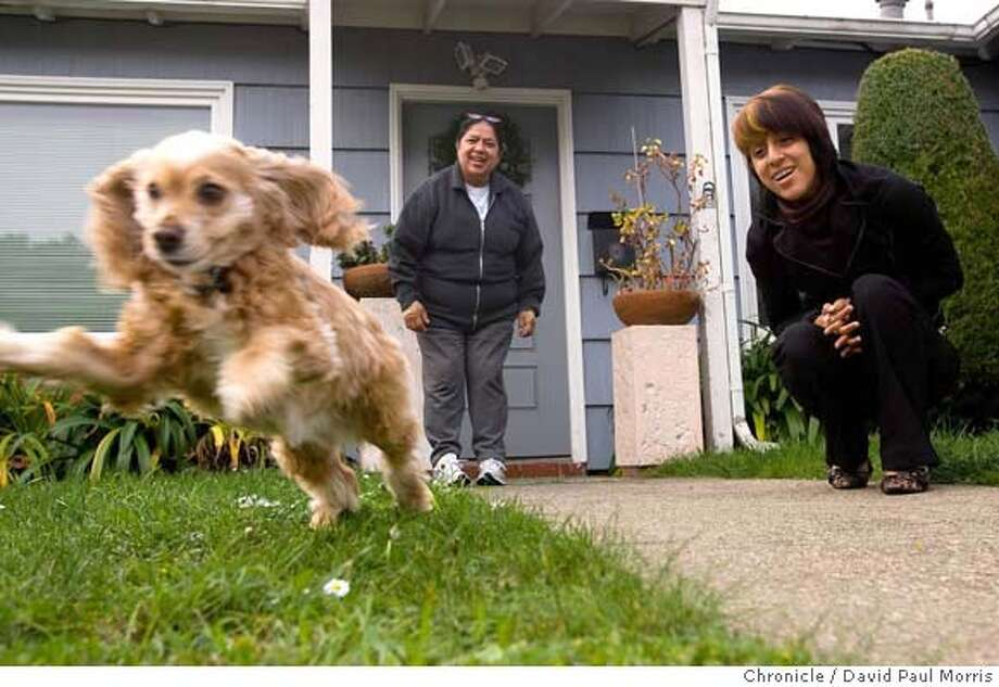 SOUTH SAN FRANCISCO, CA - DEC 5: Maria Irma Pineda, 50 with her daughter Irma Tellez, 19 and their dog Necutli at their home on December 5, 2007 in South San Francisco. Irma (the mom) and her husband both work as janitors; they're strapped for back rent becasue her father has been in the ICU in a coma for several months. (Photo by David Paul Morris / The Chronicle) Photo: David Paul Morris