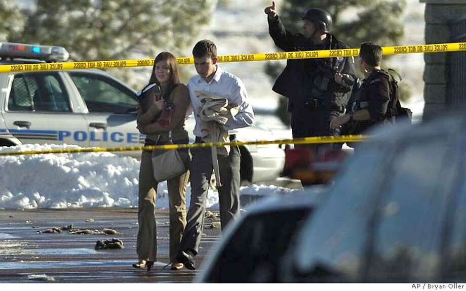 Law enforcement officials swarm New Life Church on Sunday, Dec. 9, 2007 in Colorado Springs, Colo. A gunman killed two staff members at a missionary training center early Sunday in Arvada after being told he couldn't spend the night, and about 12 hours later four people were shot outside New Life Church in Colorado Springs. It was not immediately known whether the shootings were related, but Arvada authorities said they were sharing information with Colorado Springs investigators. (AP Photo/The Gazette, Bryan Oller) ** NO MAGS NO SALES ** Photo: Bryan Oller