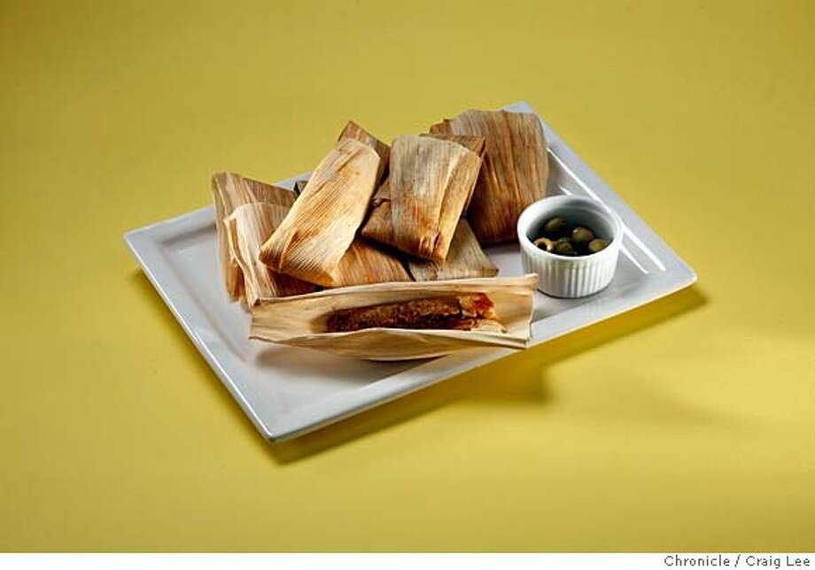 XMASPAIRINGS21_058_cl.JPG  Photo of four dishes against different colored backgrounds to be paired with wine photographed against different colored backgrounds. This is a photo of Tamales, styled by Tara Duggan.  on 12/11/07 in San Francisco. photo by Craig Lee / The Chronicle MANDATORY CREDIT FOR PHOTOG AND SF CHRONICLE/NO SALES-MAGS OUT Photo: Photo By Craig Lee