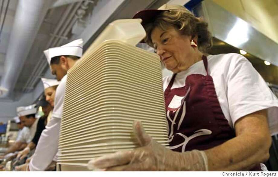 Mary Jane Zismann (cq) Volunteers on the assembly line putting together meals for thousand's at Project Open Hand in San Francisco.  VOLUNTEERS_0015_KR.jpg  Kurt Rogers / The Chronicle Photo taken on 11/15/07, in San Francisco, CA, USA MANDATORY CREDIT FOR PHOTOG AND SAN FRANCISCO CHRONICLE/NO SALES-MAGS OUT Photo: Kurt Rogers