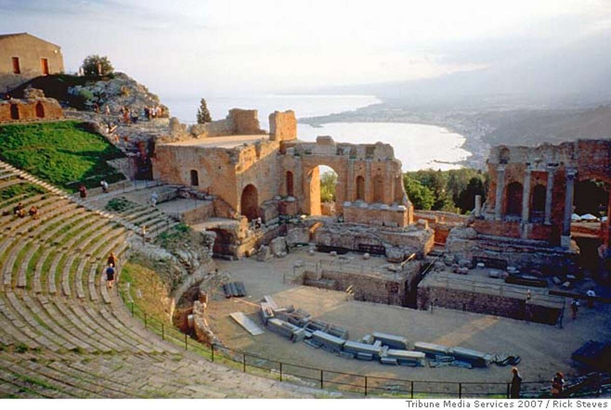TRAVEL STEVES SICILY -- The Greek theater in Taormina, Sicily: With a view like this, no play is a tragedy. Rick Steves / Tribune Media Services 2007