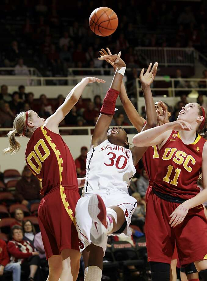 Southern California forwards Christina Marinacci (00) and forward Cassie Harberts (11) and Stanford forward Nnemkadi Ogwumike (30) vie for rebound in the first half of an NCAA college basketball game in Stanford, Calif., Thursday, Feb. 9, 2012. (AP Photo/Paul Sakuma) Photo: Paul Sakuma, Associated Press