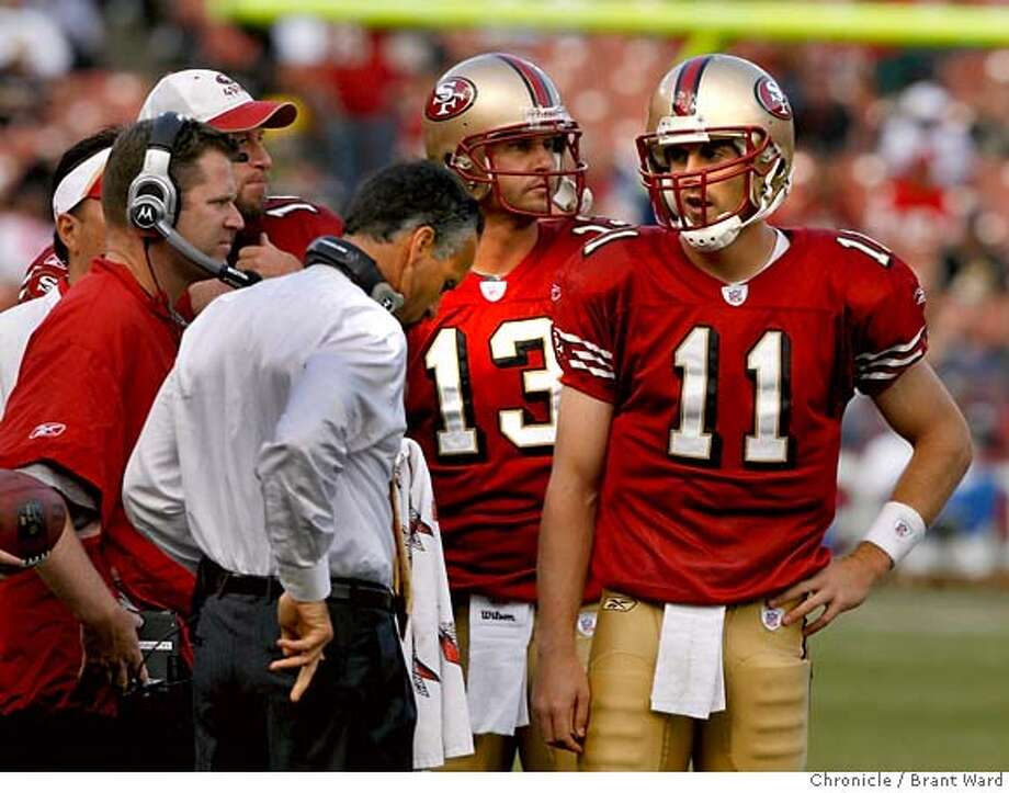 Quarterback Alex Smith (11), with a sore right shoulder, confers with head coach Mike Nolan during the fourth quarter  in Oct. 2007.  Mike Nolan let Smith play the entire game with a sore right shoulder. Smith was sacked twice and ran four times. Photo: Brant Ward