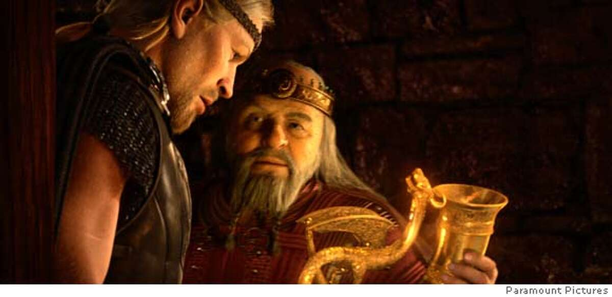 As a reward for his heroism, the Viking hero, Beowulf (left), is offered a precious reward by the grateful King Hrothgar (right) in
