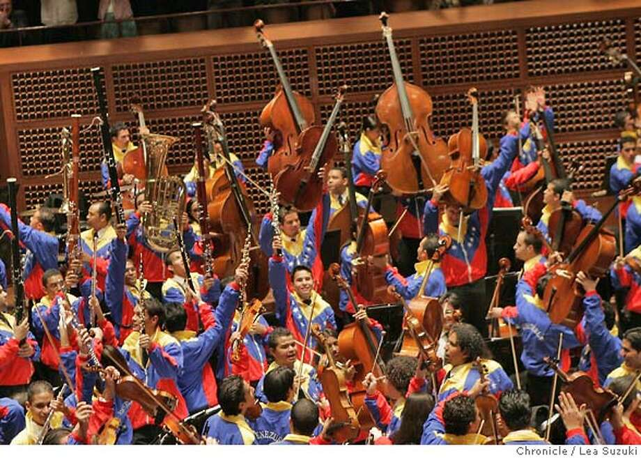 bolivar_186_ls.jpg  Orchestra members dance and raise their instruments during the encore. Venezuela's Simon Bolivar Youth Orchestra under conductor Gustavo Dudamel perform at Davies Symphony Hall. Lea Suzuki / The Chronicle Photo taken on 11/4/07 in San Francisco, CA, USA. Ran on: 11-06-2007  Orchestra members raise their instruments during the encore at Davies Symphony Hall. Photo: Lea Suzuki