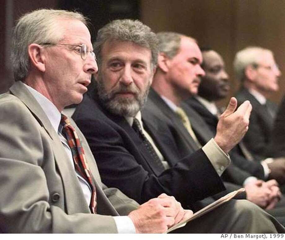 George Zimmer, second from left, gestures to Andy Dolich prior to their presentation to the Alameda County Board of Supervisors meeting Thursday, May 6, 1999, in Oakland, Calif. Dolich and Zimmer are part of two rival bidders who hope to purchase the Oakland Athletics baseball franchise. (AP Photo/Ben Margot) ALSO RAN: 5/13/99 09/17/1999 CAT Photo: BEN MARGOT