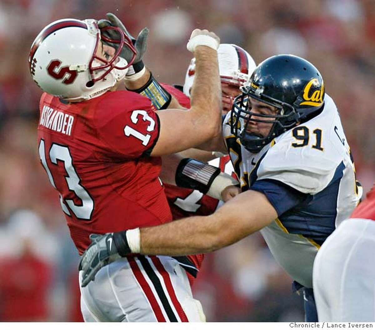 Stanford's T.C. Ostrander is hit hard by Cal's Cody Jones in first half action.CAL vs. STANFORD in the 110 annual Big Game in Stanford Stadium. Lance Iversen/San Francisco Chronicle (cq) SUBJECT 12/01/07,in PALO ALTO Ca.