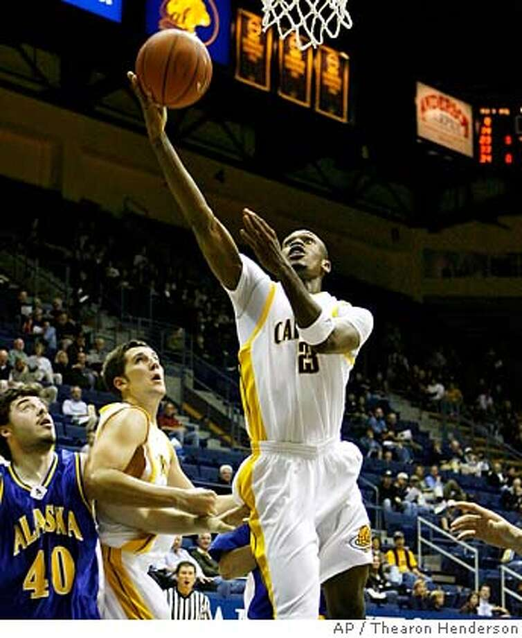 California Patrick Christopher (23) goes down the middle to lay the ball up for two points before Alaska-Fairbanks' Mladen Begojevic (40) can stop him during first half action of their NCAA basketball game in Berkeley, Calif., Thursday, Nov. 8, 2007. (AP Photo/Thearon Henderson) EFE OUT EFE OUT Photo: Thearon Henderson
