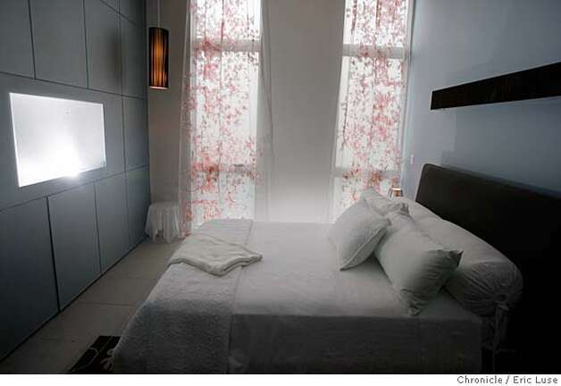 sunset_ideahome235_el.jpg Master bedroom with a glass wall which includes a window in which to house a television.  Sunset Idea Home opens Dec8-9. Claims to be a completely green home. Eric Luse / The Chronicle Photo taken on 12/3/07, in San Francisco, CA, USA  Names cq from source  Sandra & Tony Serpa MANDATORY CREDIT FOR PHOTOG AND SAN FRANCISCO CHRONICLE/NO SALES-MAGS OUT Photo: Eric Luse
