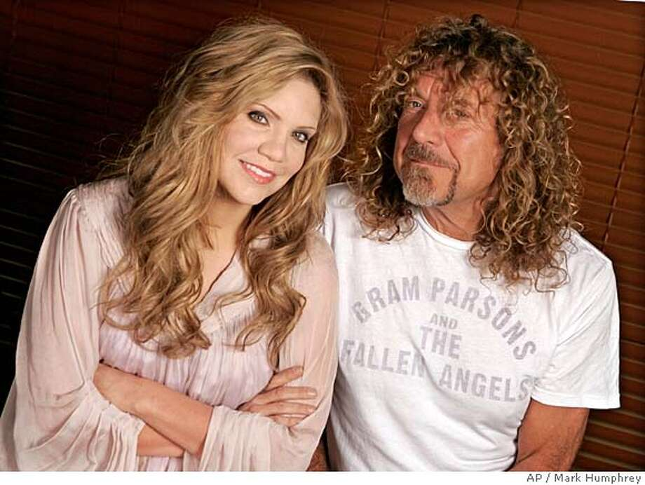 "Bluegrass star Alison Krauss and singer Robert Plant are photographed in Nashville, Tenn., on Oct. 11, 2007. The two have put their different styles together on the album ""Raising Sand,"" and what results is neither rock, nor bluegrass. (AP Photo/Mark Humphrey) Photo: Mark Humphrey"