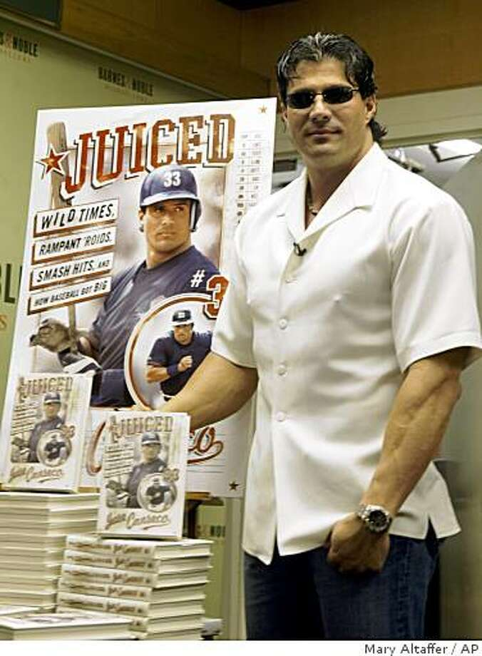 """Jose Canseco poses for photographers next to a display of his of autobiography, """"Juiced: Wild Times, Rampant 'Roids, Smash Hits, and How Baseball Got Big""""; during a signing at a Barnes & Noble bookstore in New York, Wednesday, Feb. 23, 2005. (AP Photo/Mary Altaffer) Photo: Mary Altaffer, AP"""