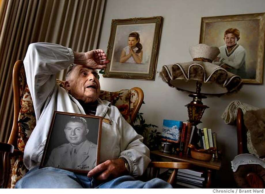 latinovets_314.JPG  William Carrillo holds a portrait of himself taken in 1945 after he returned from the POW camp and the war ended. He is recalling his adventures fighting the Nazis. Portraits of his children hang on the wall.  An estimated half a million Latinos served in the armed services during World War II. Daly City resident William Carrillo, was one of those. He bluffed his way into flight training, flew many missions over France and Germany. Then he was shot down over Berlin, landed in a house, was captured and tortured by the Gestapo and eventually ended up in a POW camp until the end of the war.  {By Brant Ward/San Francisco Chronicle}11/5/07 Photo: Brant Ward