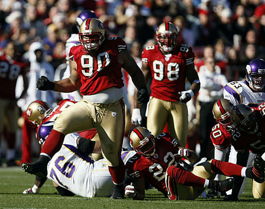 Niners #90 Isaac Sopoaga celebrates his tackle behind the line of scrimage in first half action. 49ERS_VIKINGS NFL game at Monster Park in San Francisco Photo: Lance Iversen, The Chronicle