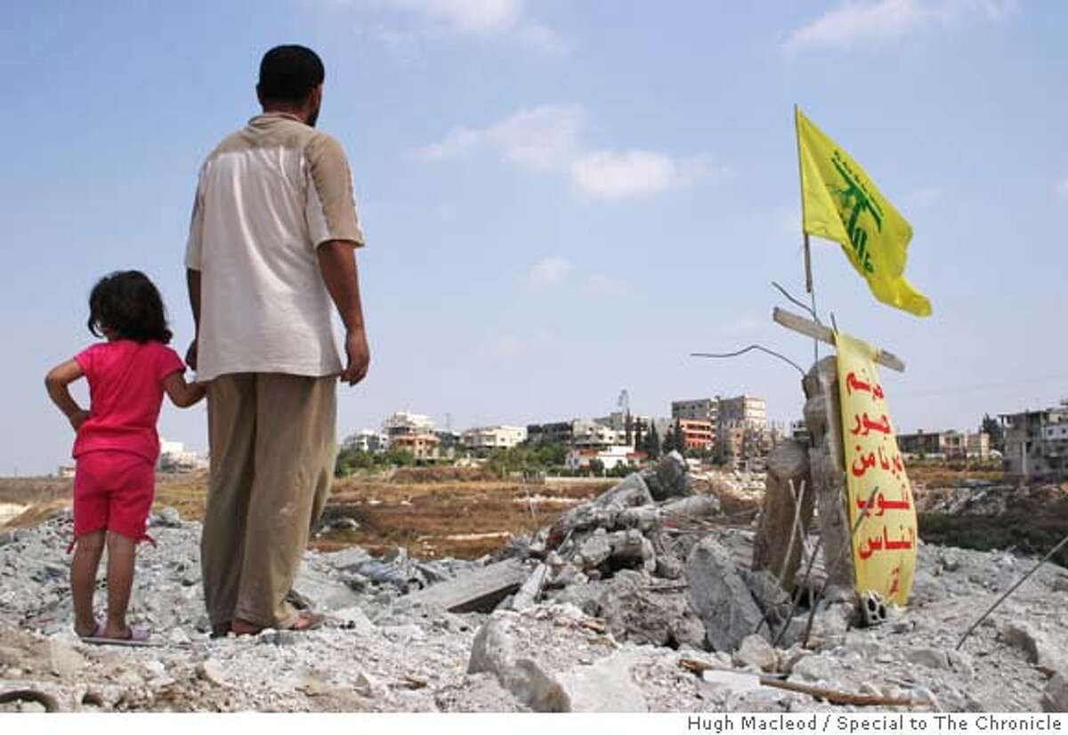 Caption: A cousin of Hezbollah leader Hassan Nasrallah stands over the rubble of his home in the southern Lebanese town of Bazouriyeh, bombarded by Israel during its war last summer with Hezbollah. Since then, not only has the Shiite militant group made good on pledges to rebuild homes, it has launched a pan-sectarian recruitment drive, swelling the ranks of its fighters by thousands and arming a Palestinian Sunni militia inside Lebanon's most violent refugee camp. CR: Hugh Macleod / Special to The Chronicle MANDATORY CREDIT FOR PHOTOG AND SAN FRANCISCO CHRONICLE/NO SALES-MAGS OUT