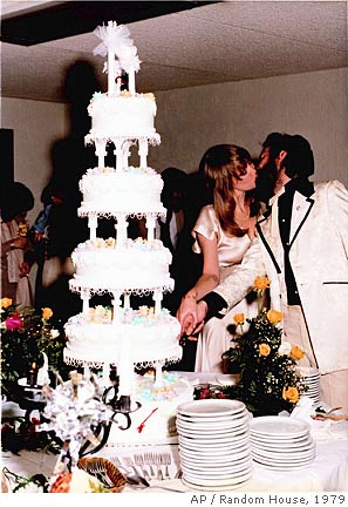 ** ADVANCE FOR MONDAY, OCT. 15 **In this photo released by Random House, Eric Clapton joins Pattie Boyd Harrison, former wife of Beatle George Harrison, as they cut their wedding cake in Tucson, Ariz, March 27, 1979. Their star-crossed affair made her the muse for some of Clapton's most memorable songs, including