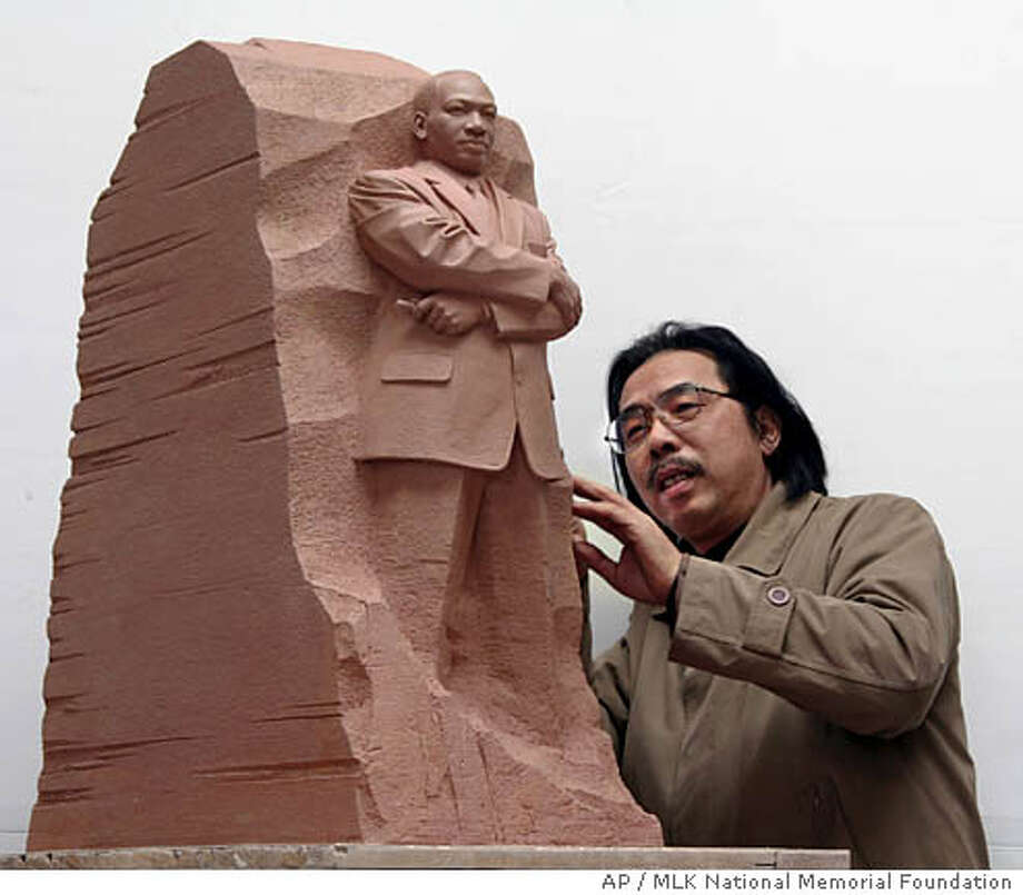 "In this undated photograph released by the MLK National Memorial Foundation, sculptor Master Lei Yixin of China looks at a scale model of the ""Stone of Hope,"" a piece he has created which will be the centerpiece of the new . (AP Photo/MLK National Memorial Foundation) ** NO SALES ** Photo: Anonymous"